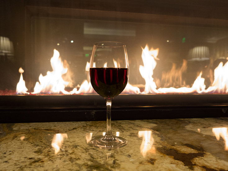 Wine and fireplace in lobby at Hotel Monaco
