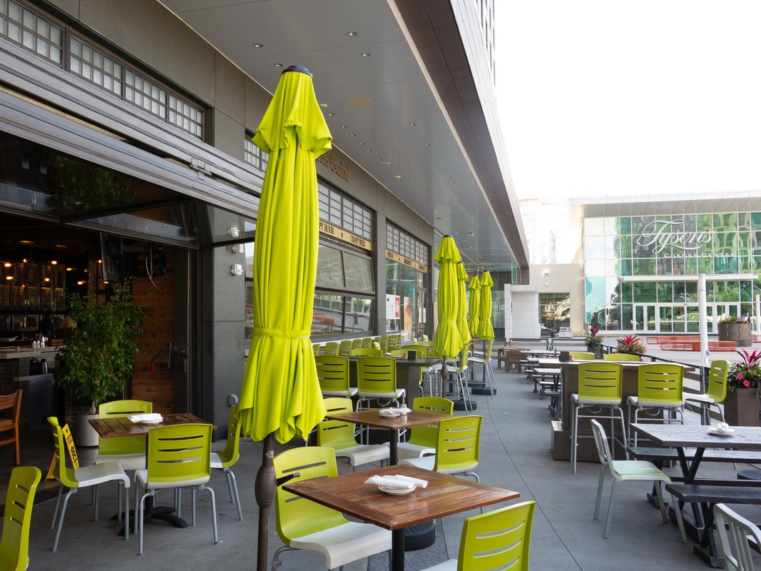 Outside seating on the Plaza at Barrel & Bushel in Hyatt Regency Tysons Corner Center